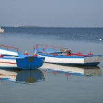 some fishers' boats in the crystal-clear water