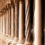 A line of ornate columns in the cloister of Monreale.
