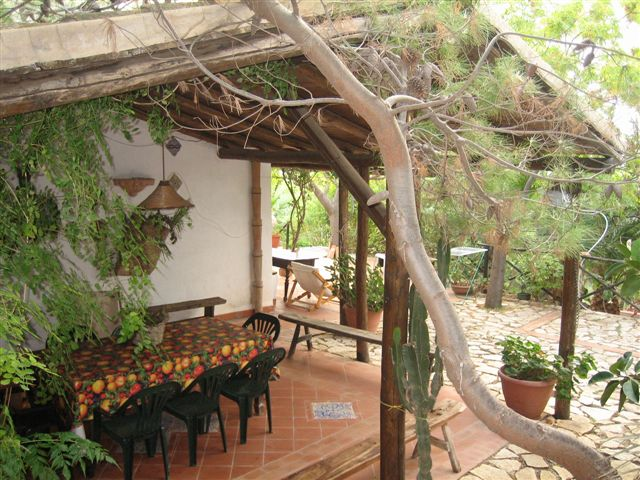 the covered terrace with dining area
